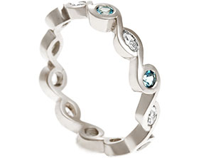 17829-white-gold-marquise-diamond-and-swiss-blue-topaz-eternity-ring_1.jpg