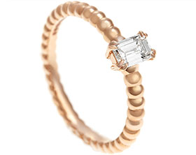 17872-rose-gold-emerald-cut-diamond-ring-with-bubble-style-detailing_1.jpg