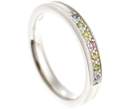 17487-fairtrade-9-carat-white-gold-eternity-ring-with-multi-coloured-sapphires_1.jpg
