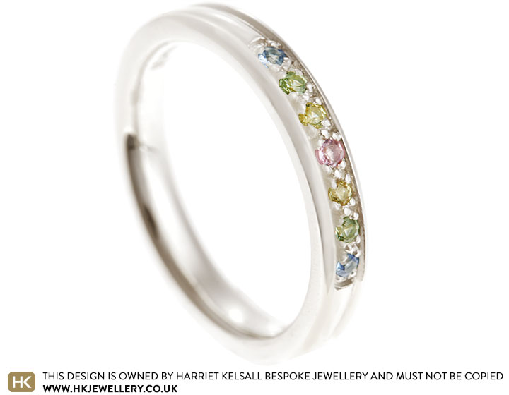 17487-fairtrade-9-carat-white-gold-eternity-ring-with-multi-coloured-sapphires_2.jpg