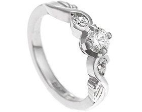17582-palladium-twist-style-engagement-ring-with-feather-detailing_1.jpg