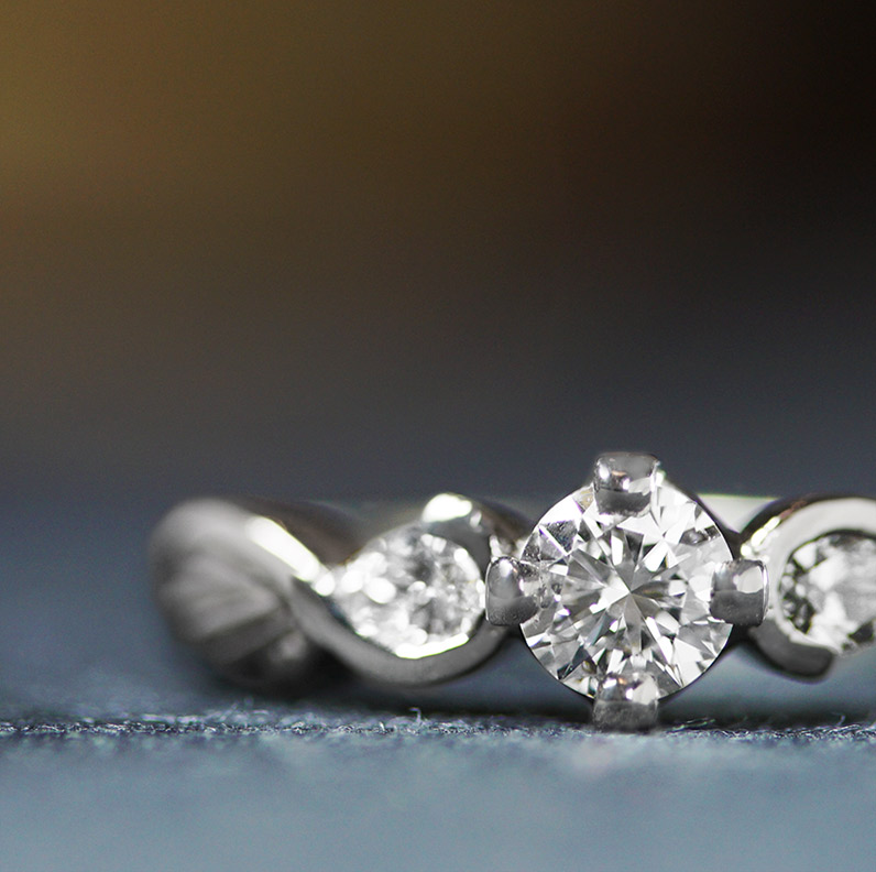 17582-palladium-twist-style-engagement-ring-with-feather-detailing_9.jpg