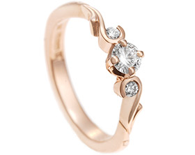 17584-rose-gold-trilogy-style-engagement-ring-with-curl-detail_1.jpg