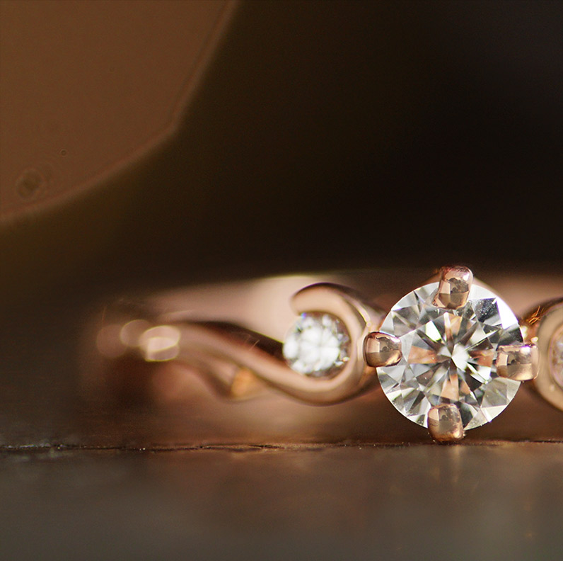 17584-rose-gold-trilogy-style-engagement-ring-with-curl-detail_9.jpg