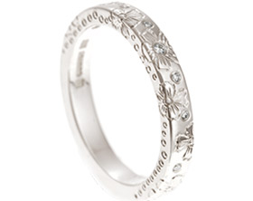 17740-white-gold-and-diamond-hibiscus-engraved-eternity-ring_1.jpg