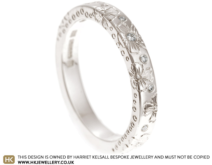 17740-white-gold-and-diamond-hibiscus-engraved-eternity-ring_2.jpg