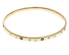 17798-yellow-gold-sapphire-and-diamond-bangle-with-customers-own-stones_1.jpg
