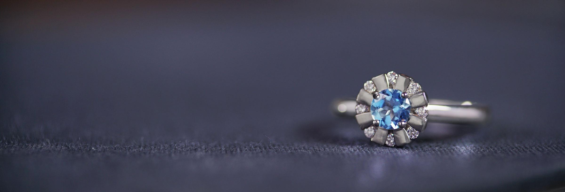 platinum-engagement-ring-with-aquamarine-centre-and-diamond-halo