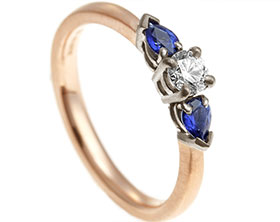 17948-mixed-metal-diamond-and-sapphire-trilogy-satinised-engagement-ring_1.jpg