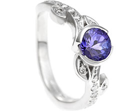 18003-palladium-rose-inspired-engagement-ring-with-central-tanzanite_1.jpg