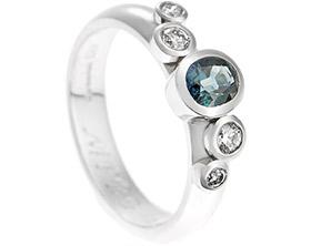 18034-palladium-oval-cut-blue-green-sapphire-with-all-round-set-diamonds_1.jpg