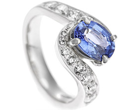 18065-platinum-twist-style-ring-with-diamonds-and-central-sapphire_1.jpg