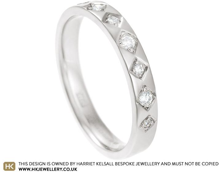 11550-white-gold-eternity-ring-with-grain-set-diamonds_2.jpg