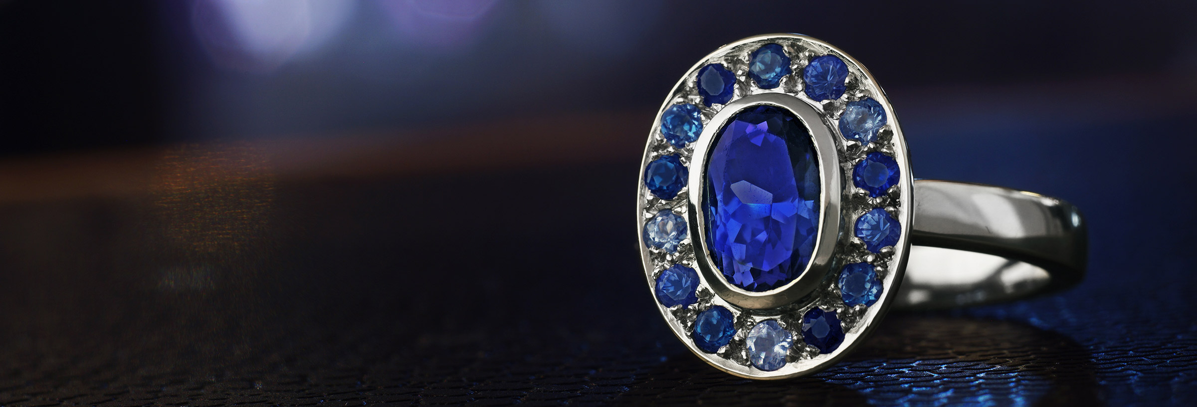 under-the-sea-inspired-platinum-engagement-ring-with-185ct-oval-cut-tanzanite