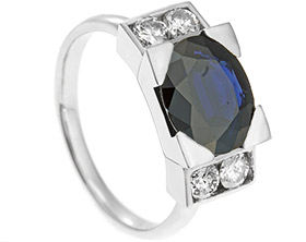 18188-platinum-dress-ring-with-oval-cut-sapphire-and-diamond-shoulders_1.jpg