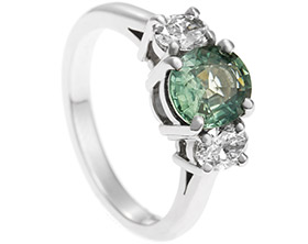 18282-palladium-oval-cut-green-sapphire-and-diamond-trilogy-engagement-ring_1.jpg