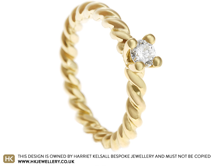 17412-yellow-gold-twisting-band-solitaire-diamond-engagement-ring_2.jpg