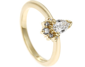 17912-fairtrade-yellow-gold-engagement-ring-with-pear-and-round-brilliant-diamonds_1.jpg