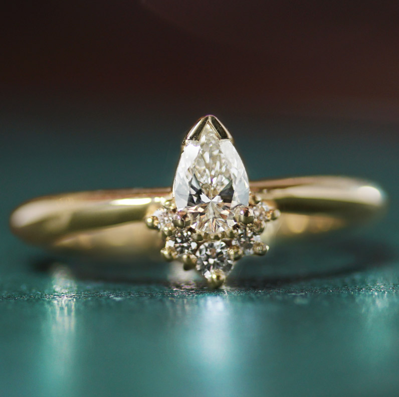 17912-fairtrade-yellow-gold-engagement-ring-with-pear-and-round-brilliant-diamonds_9.jpg