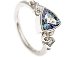 17985-fairtrade-9-carat-white-gold-engagement-ring-with-tanzanite-and-diamonds_1.jpg