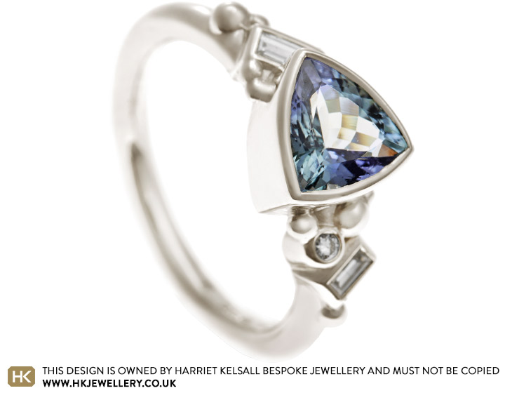 17985-fairtrade-9-carat-white-gold-engagement-ring-with-tanzanite-and-diamonds_2.jpg