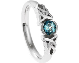18410-celtic-knot-inspired-engagement-ring-with-central-topaz-and-diamonds_1.jpg