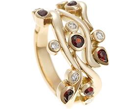 18449-yellow-gold-diamond-and-garnet-intertwining-dress-ring_1.jpg