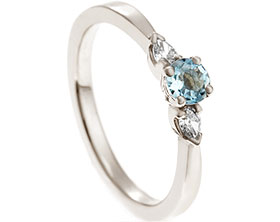 18527-18-carat-white-gold-trilogy-engagement-ring-with-diamond-and-aquamarine_1.jpg