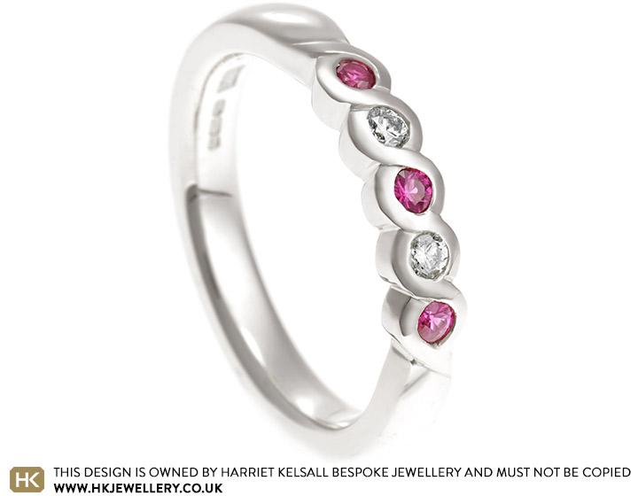 18662-diamond-and-pink-sapphire-white-gold-eternity-ring_2.jpg