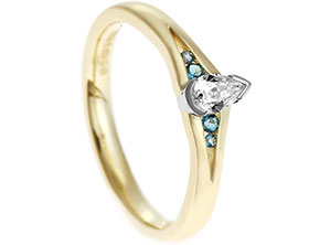 18512-yellow-gold-and-palladium-pear-cut-diamond-and-blue-topaz-engagement-ring_1.jpg