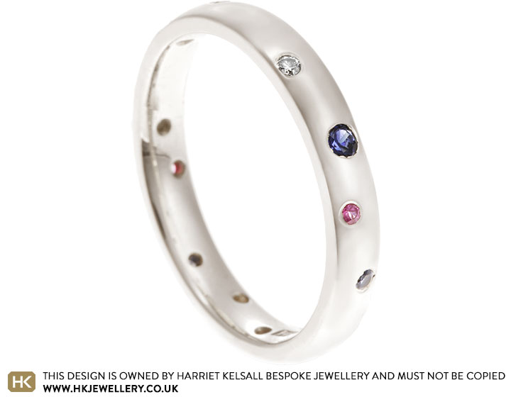 9834-fairtrade-white-gold-scatter-set-diamond-and-sapphire-eternity-ring_2.jpg