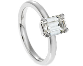18777-palladium-and-emerald-cut-moissanite-engagement-ring_1.jpg