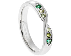 18785-mobius-twist-style-eternity-ring-with-graduating-green-stones_1.jpg
