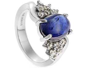 18806-cabochon-oval-sapphire-with-diamonds-and-twisted-band-engagement-ring_1.jpg