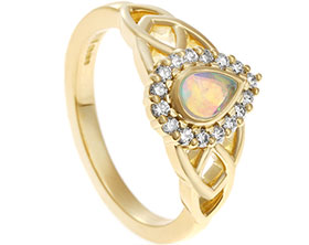 18877-yellow-gold-engagement-ring-with-pear-cut-opal-and-diamonds_1.jpg