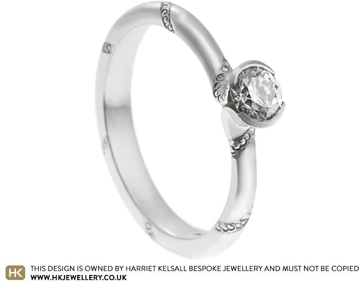 13868-platinum-engagement-ring-with-diamond-and-wrap-engraving-detail_2.jpg