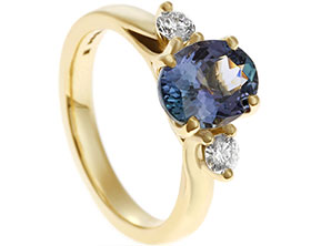 18569-yellow-gold-trilogy-engagement-ring-with-diamond-and-tanzanite_1.jpg
