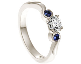 18947-white-gold-diamond-and-sapphire-curl-trilogy-engagement-ring_1.jpg