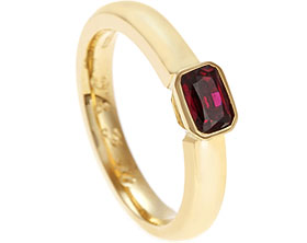 18949-yellow-gold-and-emerald-cut-ruby-eternity-ring_1.jpg