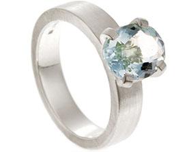 19090-satinised-white-gold-and-claw-set-aquamarine-dress-ring_1.jpg