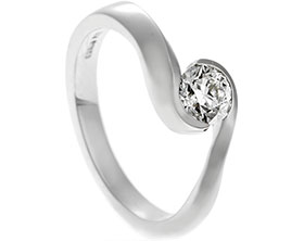19160-platinum-and-tension-set-diamond-solitaire-engagement-ring_1.jpg