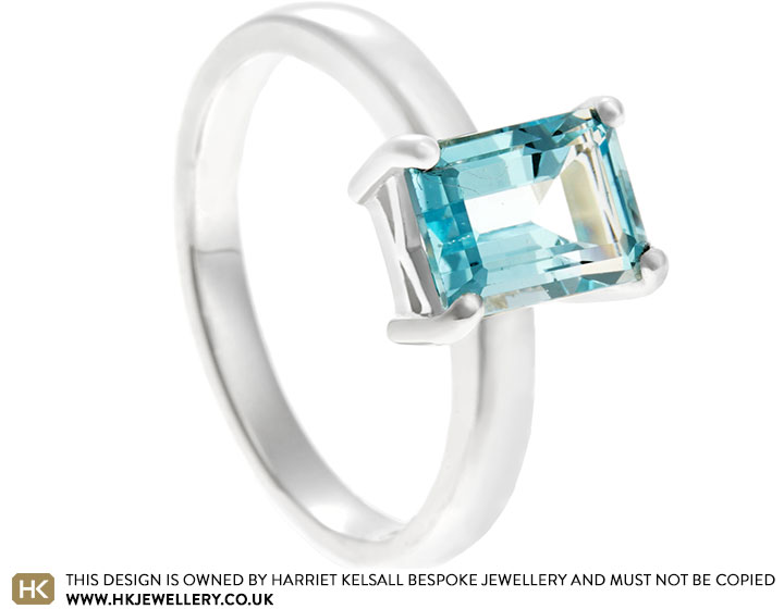 19482-sterling-silver-dress-ring-with-emerald-cut-topaz_2.jpg