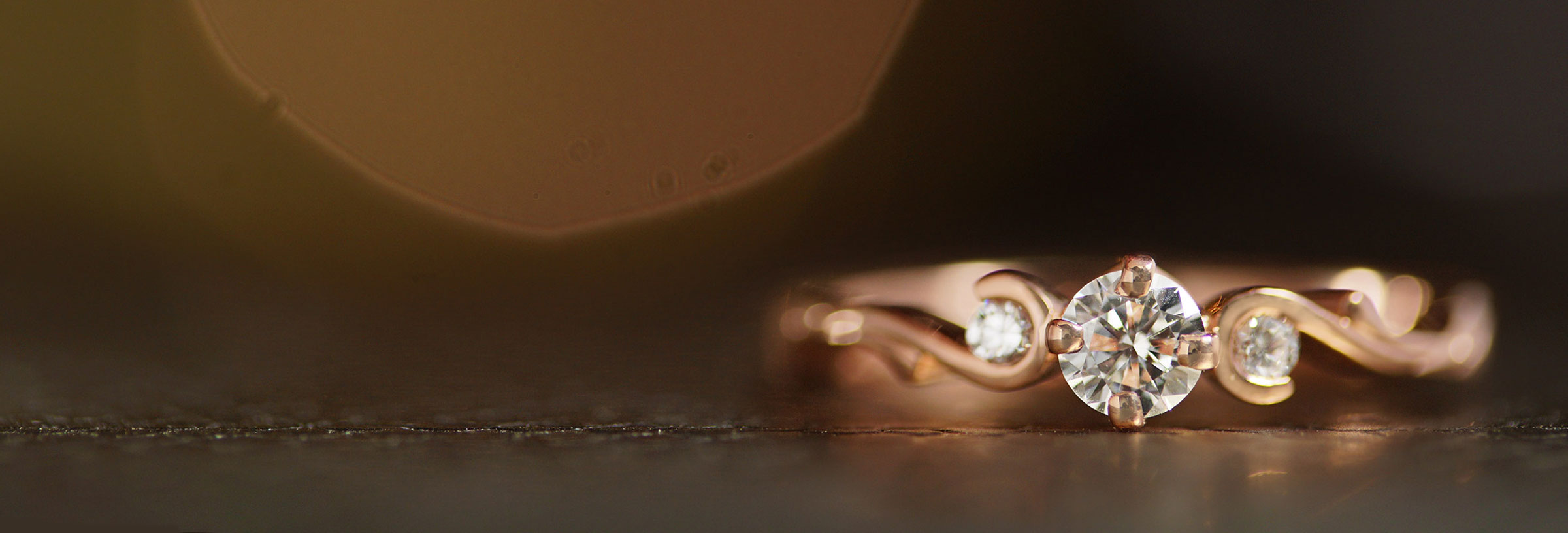 rose-gold-trilogy-style-engagement-with-curl-detail