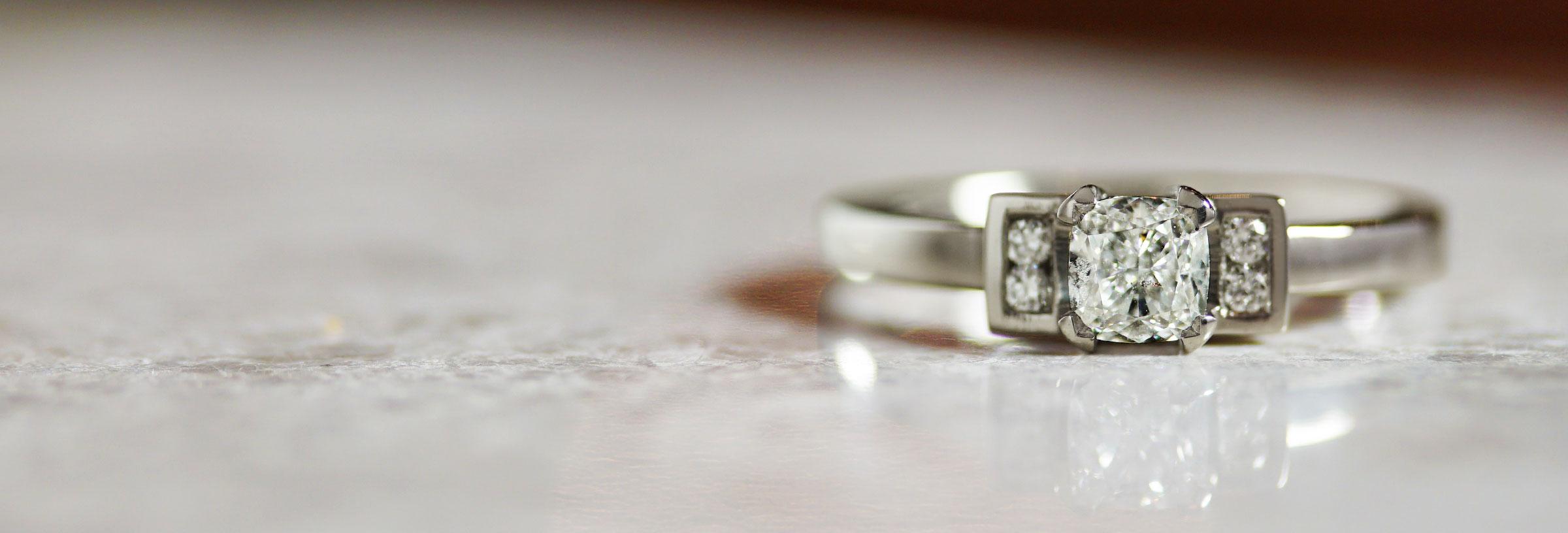 cushion-cut-diamond-and-palladium-five-stone-engagement-ring