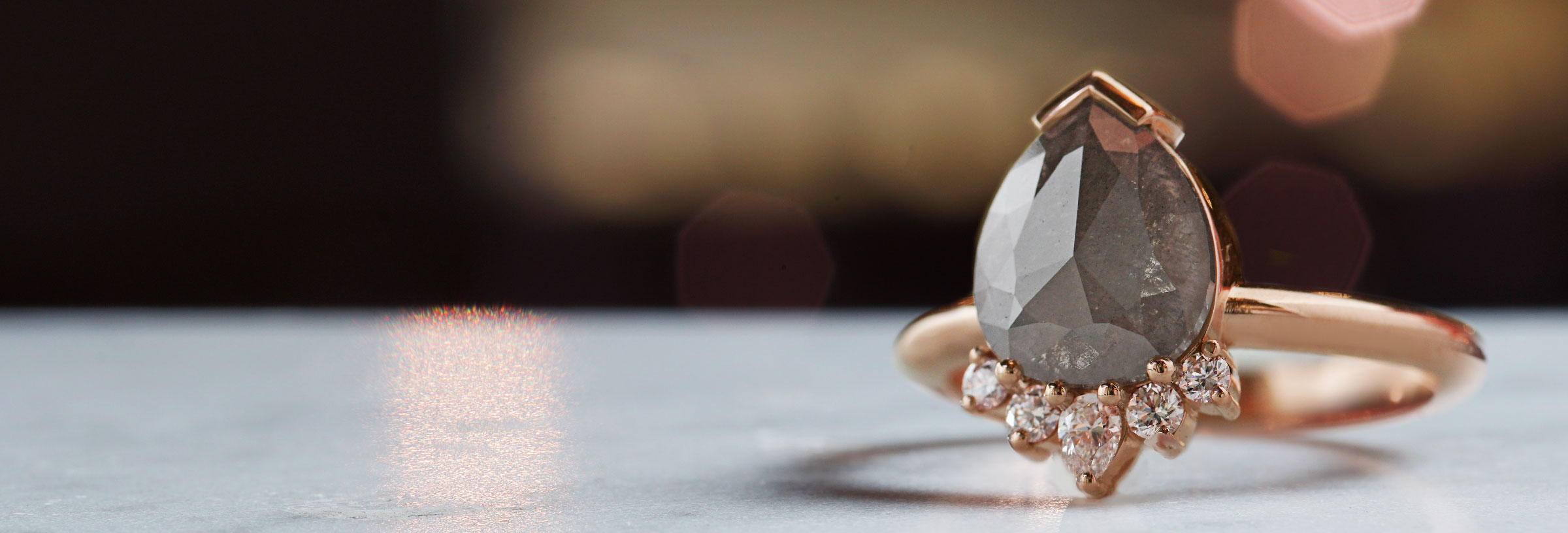 rose-gold-engagement-ring-with-grey-pear-cut-diamond
