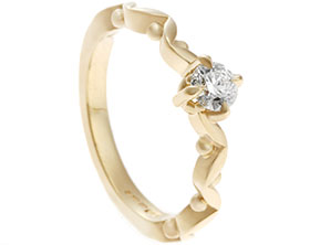 18704-yellow-gold-diamond-engagement-ring-with-marquise-and-sphere-shaped-band_1.jpg