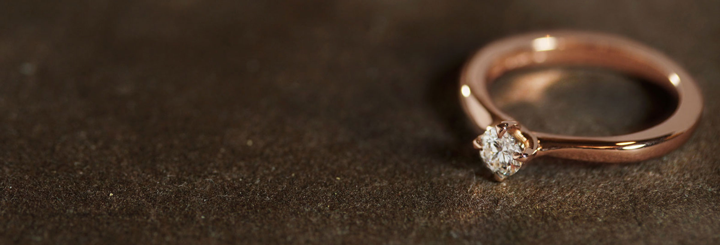rose-gold-and-diamond-solitaire-mobius-twist-engagement