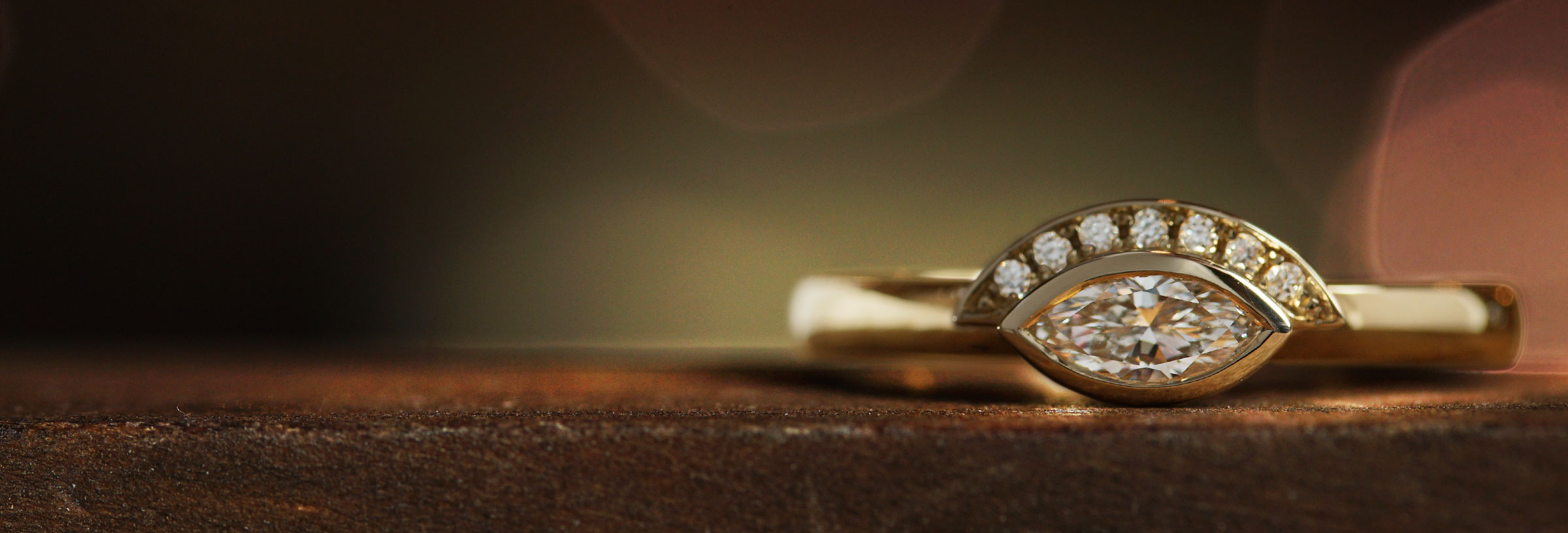 yellow-gold-marquise-cut-diamond-engagement-ring-with-half-halo