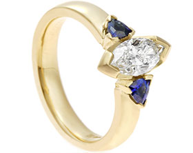18299-yellow-gold-marquise-diamond-and-trilliant-sapphire-trilogy-engagement-ring_1.jpg
