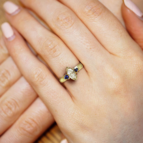 18299-yellow-gold-marquise-diamond-and-trilliant-sapphire-trilogy-engagement-ring_5.jpg